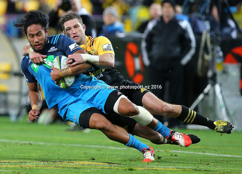 Blues' Matt Vaega is tackled by Hurricanes' Cory Jane during the round 15 Super Rugby match, Hurricanes v Blues at Westpac Stadium, Wellington, New Zealand. 2nd July 2016. © Copyright Photo: Grant Down / www.photosport.nz
