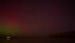 © Licensed to London News Pictures. 27/02/2014<br /> <br /> Saltburn, England<br /> <br /> The Aurora Borealis is visible over the area known as Huntcliff in Saltburn by the Sea in Cleveland.<br /> <br /> Photo credit : Ian Forsyth/LNP