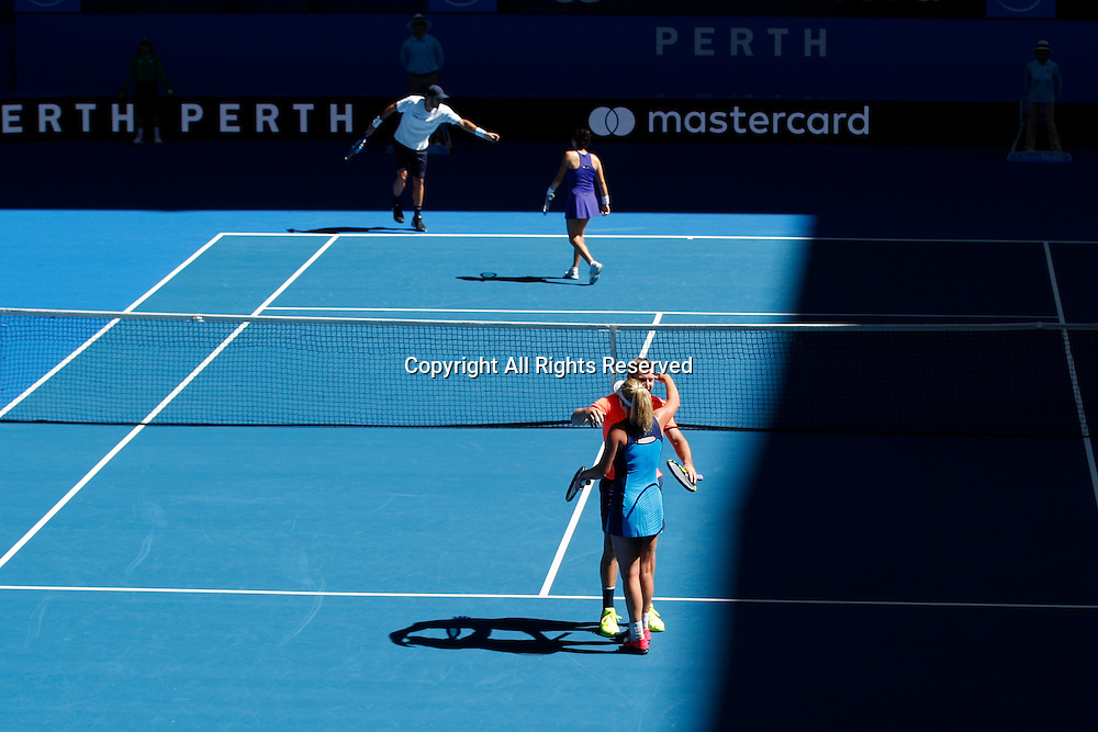 03.01.2017. Perth Arena, Perth, Australia. Mastercard Hopman Cup International Tennis tournament. Team USA Jack Sock and Coco Vandeweghe congratulate each other on winning the mixed doubles against Spain 4-3, 3-4, 4-3.