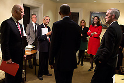 President Barack Obama talks with, from left, Vice President Joe Biden; Shaun Donovan, Director, Office of Management and Budget; John Podesta, Counselor to the President; Jennifer Palmieri, Director of Communications; Katie Beirne Fallon, Director of Legislative Affairs; National Security Advisor Susan E. Rice and Chief of Staff Denis McDonough, in a West Wing hallway of the White House, Nov. 7, 2014. (Official White House Photo by Pete Souza)<br /> <br /> This official White House photograph is being made available only for publication by news organizations and/or for personal use printing by the subject(s) of the photograph. The photograph may not be manipulated in any way and may not be used in commercial or political materials, advertisements, emails, products, promotions that in any way suggests approval or endorsement of the President, the First Family, or the White House.