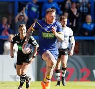 Josh Charnley of Warrington Wolves runs over to score the try against Toronto Wolfpack during the Ladbrokes Challenge Cup match at the Halliwell Jones Stadium, Warrington<br /> Picture by Stephen Gaunt/Focus Images Ltd +447904 833202<br /> 13/05/2018