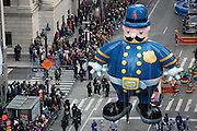 The Police Officer balloon goes down 6th Avenue for the 89th annual Macy's Thanksgiving Day Parade as seen from above street level on Thursday, Nov. 26, 2015, in New York. (Photo by Ben Hider/Invision/AP)