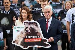 © Licensed to London News Pictures. 04/06/2018. London, UK. Sue Hayman MP (L) and Shadow Chancellor John McDonnell (R) join a silent protest outside Parliament calling for a ban on fur. MPs are to debate the introduction of a ban on fur imports. Photo credit: Rob Pinney/LNP