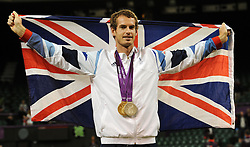 File photo dated 05-08-2012 of Great Britain's Andy Murray wears his Olympic Gold and Silver Medals at the Olympic Tennis Venue, Wimbledon.