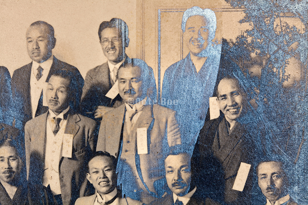 group portrait of business people in a partly silver mirroring photograph Japan