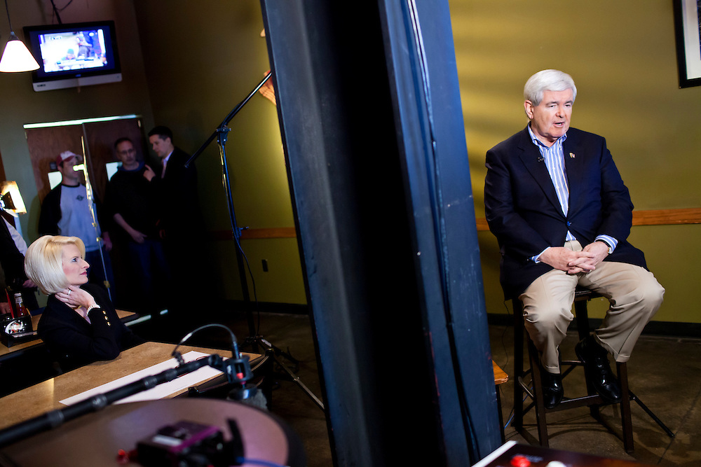 Republican presidential candidate Newt Gingrich tapes a segment for FOX News before meeting with voters at the West Towne Pub on Sunday, January 1, 2012 in Ames, IA.