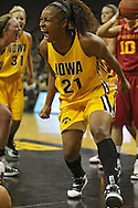 December 09 2010: Iowa guard Kachine Alexander (21) is pumped up after a score and foul during the first half of their NCAA basketball game at Carver-Hawkeye Arena in Iowa City, Iowa on December 9, 2010. Iowa defeated Iowa State 62-40 in the Hy-Vee Cy-Hawk Series rivalry game.