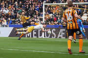 Sheffield Wednesday forward Jordan Rhodes (7) heads the ball towards goal and goes close during the EFL Sky Bet Championship match between Hull City and Sheffield Wednesday at the KCOM Stadium, Kingston upon Hull, England on 14 April 2018. Picture by Mick Atkins.