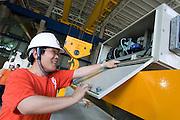 Kone Cranes Training Manager Enzhi LI checks an Heavy Duty Semi-Automatic 60 + 60 ton Kone Crane in Oji Paper Factory, in Nantong, Jiangsu province, China, on May 25, 2010. Photo by Lucas Schifres/Pictobank