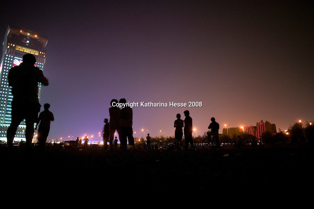 BEIJING, AUGUST 5 : Beijingers watch the dress rehearsals for the Olympic Games from nearby the National Stadium.