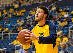 Feb 20, 2016; Morgantown, WV, USA; West Virginia Mountaineers forward Nathan Adrian (11) warms up before their game against the Oklahoma Sooners at the WVU Coliseum. Mandatory Credit: Ben Queen-USA TODAY Sports