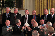 Members of  former Specialist Five James C. McCloughan unit stand up as President Donald Trump presenting the Medal of Honor to former Specialist Five James C. McCloughan, U.S. Army.in the East Room of the White House on July 31, 2017<br />