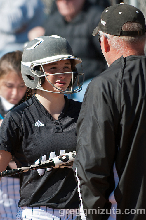 Coach Kelly Johnson talks to freshman Grace Reever before the start of the Vale Payette softball game, March 22, 2014 at Payette, Idaho.