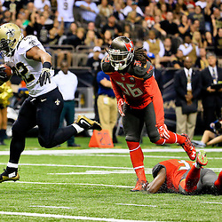 Sep 20, 2015; New Orleans, LA, USA; New Orleans Saints running back Mark Ingram (22) runs for a touchdown against the Tampa Bay Buccaneers during the second quarter of a game at the Mercedes-Benz Superdome. Mandatory Credit: Derick E. Hingle-USA TODAY Sports