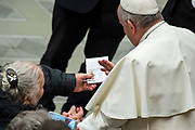 Pope Francis blesses the sick at the end of his weekly general audience at the Paul VI hall on February 07, 2018 at the Vatican.