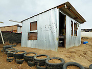 The iShack: The simple, solar-powered home that could transform life for slum-dwellers<br /> <br /> Meet the iShack, a modern take on an age-old design that is bringing new hope – and light – to the slums of South Africa.<br /> Millions of people are unable to afford to move out of slums and shanty towns in sub-Saharan Africa but the development of the iShack is intended to lift their living standards.<br /> People living in rickety and makeshift shacks in slum areas can wait for years before they can get connected to the electricity or water grids, and the United Nations estimates that 62 per cent of the urban population in Sub-Saharan Africa lives in slums.<br /> With the iShack, the 'improved shack', they get a solid dwelling that is fitted with enough solar panels to keep the lights on at night and provide power for important equipment such as mobile phone chargers.<br /> It is an initiative from researchers at the University of Stellenbosch in South Africa which they hope can allieviate poverty across the country and beyond its borders.<br /> Housing backlogs, government budgetary restrictions and a rise in the number of people moving to urban areas means it will be many years before the shacks of slums can be cleared away and replaced with bricks and mortar.<br /> <br /> <br /> Andreas Keller, one of the project leaders, said: 'Shacks are becoming the new norm.<br /> 'So what can we do today in order to improve the living conditions of people through energy intervention, lighting, cell phones, communication, upping security?<br /> 'That's where the planning comes in and the technology takes it one step further.'<br /> Each shack iShack costs about £410 ($660) and they have been deliberately designed to be as user-friendly as possible.<br /> <br /> Windows are placed to maximise air circulation and the sloping roof allows rainwater to be collected.<br /> The walls are insulated with recycled materials, a brick floor helps keep temperatures steady and flame-reta