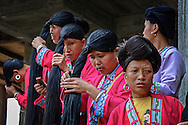 Tribal Zhuang women are brushing their long hair.