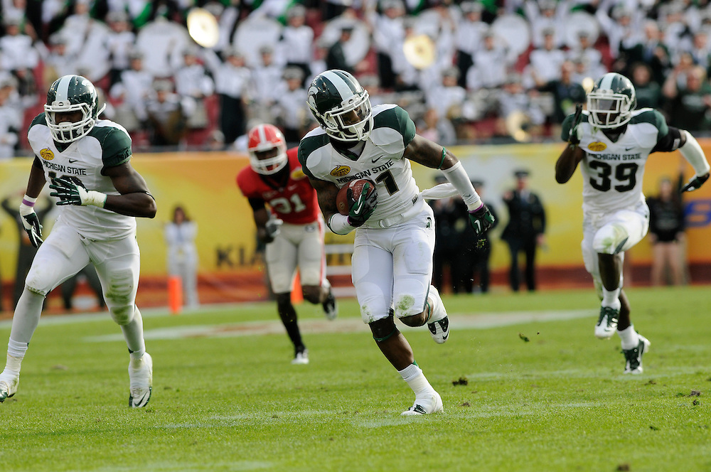 January 2, 2012: Darqueze Dennard of Michigan State returns an interception during the NCAA football game between the Michigan State Spartans and the Georgia Bulldogs at the 2012 Outback Bowl at Raymond James Stadium in Tampa, Florida. The Spartans defeated the Bulldogs 33-30.