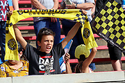 A Columbus Crew fan holds up a scarf during a MLS soccer game between FC Cincinnati and the Columbus Crew, Sunday, Aug 25th, 2019, in Cincinnati, OH. (Jason Whitman/Image of Sport)