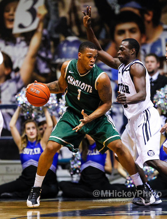 INDIANAPOLIS, IN - FEBRUARY 13: Darion Clark #1 of the Charlotte 49ers dribbles against Khyle Marshall #23 of the Butler Bulldogs at Hinkle Fieldhouse on February 13, 2013 in Indianapolis, Indiana. Charlotte defeated Butler 71-67. (Photo by Michael Hickey/Getty Images) *** Local Caption *** Darion Clark; Khyle Marshall