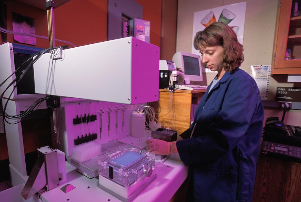 Kansas, USA - Angie Matthews with robot in KSU gene sequencing lab