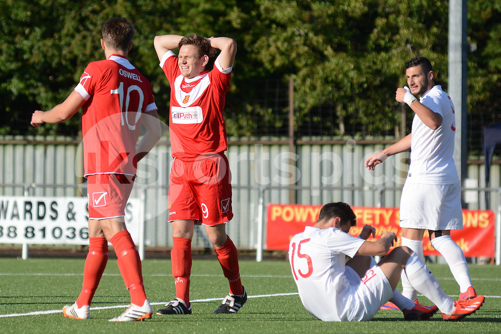 Newtown's Luke Boundford rues a missed chance during the Europa League Qualifying match between Newtown AFC and Valletta FC at Paveways Latham Park Stadium, Newtown, Powys, Wales on 2 July 2015. Photo by Garry Griffiths.