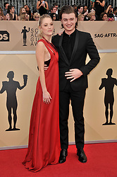Maika Monroe and Joe Keery arrives at the 24th annual Screen Actors Guild Awards at The Shrine Exposition Center on January 21, 2018 in Los Angeles, California. <br />