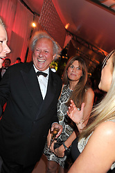 GRAYDON CARTER and JEMIMA KHAN at the Raisa Gorbachev Foundation Gala held at the Stud House, Hampton Court, Surrey on 22nd September 22 2011