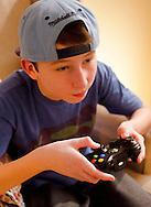 Teenage Boy playing Xbox 360 Video Game - Feb 2013.