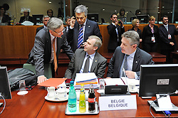 Jean-Claude Juncker, Luxembourg's prime minister, left, speaks with Yves Leterme, Belgium's prime minister, center, and Karel De Gucht, Belgium's foreign minister, right, as Didier Reynders, Belgium's finance minister, background, listens, during the European Summit, in Brussels, Belgium, Wednesday, Oct. 15, 2008.   (Photo © Jock Fistick)