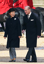 The Duke of Edinburgh with the President of the Republic of Korea Her Excellency Park Geun-hye during a Ceremonial Welcome for the President at the start of her State Visit to the UK at  Horse Guards Parade in London , Tuesday, 5th November 2013. Picture by Stephen Lock / i-Images