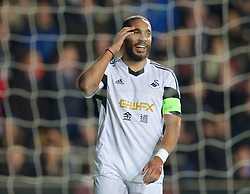 SWANSEA, WALES - Thursday, February 20, 2014: Swansea City's captain Ashley Williams looks dejected after missing a chance against SSC Napoli during the UEFA Europa League Round of 32 1st Leg match at the Liberty Stadium. (Pic by David Rawcliffe/Propaganda)
