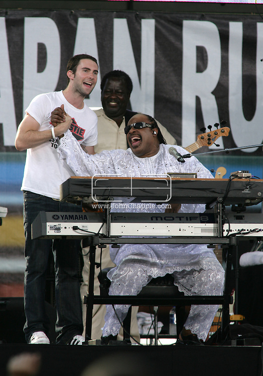 2nd July 2005, Philadelphia, PA. The USA Live 8 concert held in the city of Philadelphia. Pictured onstage is Stevie Wonder with Maroon 5's Adam Levine.  PHOTO © JOHN CHAPPLE IN THE BIG APPLE. Tel (001) 212 397 7287.www.chapple.biz