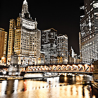 Chicago city at night along the Chicago River with Dusable Bridge (formerly Michigan Avenue Bridge), 333 North Michigan Avenue building, Crain Communications building / London Guarantee building (360 North Michigan Avenue), Kemper Building / Unitrin Building (1 East Wacker Drive), Leo Burnett building (35 West Wacker Drive), 55 West Wacker Drive building, United Airlines building (77 West Wacker Drive), and Trump International Hotel and Tower (401 North Wabash Avenue).