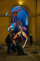 Performers rehearse for the 'Festival of Lights' parade of masked creatures and giant puppets.<br />