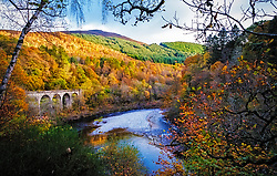 The railbridge in the pass of Killiecrankie in the Scottisch Highlands in autumn.