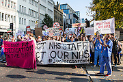 Junior doctors and other NHS staff demonstrate at the TUC No to Austerity demo outside the Conservative party conference, Manchester. 4th October 2015