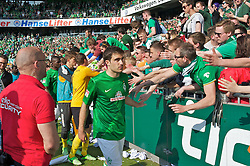 04.05.2013, Weserstadion, Bremen, GER, 1. FBL, SV Werder Bremen vs TSG 1899 Hoffenheim, 32. Runde, im Bild Sokratis Papastathopoulos (Bremen #22) nach dem Abpfiff in der Fankurve // during the German Bundesliga 32nd round match between the clubs SV Werder Bremen vs TSG 1899 Hoffenheim at the Weserstadion, Bremen, Germany on 2013/05/04. EXPA Pictures © 2013, PhotoCredit: EXPA/ Andreas Gumz ***** ATTENTION - OUT OF GER *****