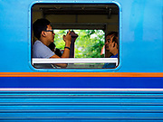 31 MAY 2017 - CHACHOENGSAO, THAILAND:  Passengers on a Bangkok bound train at the train station in Chachoengsao, a provincial town about 50 miles and about an hour by train from Bangkok. The train from Chachoengsao to Bangkok takes a little over an hour but traffic on the roads is so bad that the same drive can take two to three hours. Thousands of Thais live outside of Bangkok and commute into the city for work on trains, busses and boats.      PHOTO BY JACK KURTZ