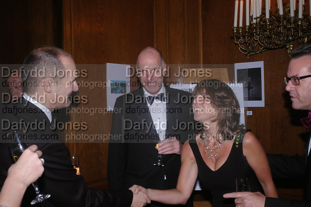 Paul Falukan,  Richard Strange and Sarah Miller. Conde Nast Traveller Tsunami Appeal dinner. Four Seasons  Hotel. Hamilton Place, London W1. 2 March 2005. ONE TIME USE ONLY - DO NOT ARCHIVE  © Copyright Photograph by Dafydd Jones 66 Stockwell Park Rd. London SW9 0DA Tel 020 7733 0108 www.dafjones.com