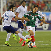 Javier Hernández, (right), Mexico, is challenged by Rafa, Portugal, during the Portugal V Mexico International Friendly match in preparation for the 2014 FIFA World Cup in Brazil. Gillette Stadium, Boston (Foxborough), Massachusetts, USA. 6th June 2014. Photo Tim Clayton