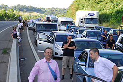 © Licensed to London News Pictures. 03/08/2013<br /> Traffic queuing on the M23 tonight (03/08/2013) outside Gatwick airport North bound towards M25 after the air ambulance lands to attend a car crash.<br /> Traffic was stopped in both directions causing long tale backs in both directions on the M23.<br /> Photo credit :Grant Falvey/LNP