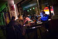 Rome, Italy - December 12, 2014: In the early evening, some patrons opt to work while others play at the easy-going bar Yeah Pigneto, in the hip neighborhood that shares the same name in Rome. CREDIT: Chris Carmichael for The New York Times