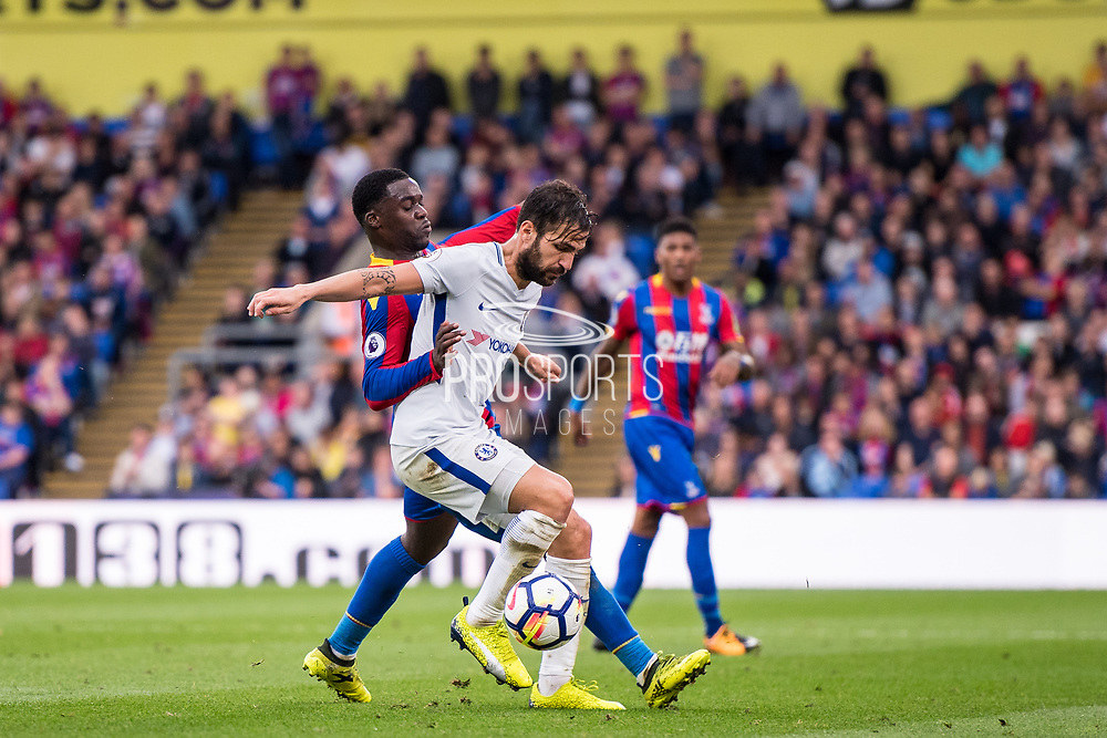 Chelsea (4) Cesc Fàbregas, Crystal Palace #15 Jeffrey Schlupp during the Premier League match between Crystal Palace and Chelsea at Selhurst Park, London, England on 14 October 2017. Photo by Sebastian Frej.