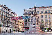 Lisbon, November 2012. Camões square at Bairro Alto district, with a monument to the great portuguese epic poet Luis de Camões (Victor Bastos, 1867), and a poster organizing a general strike related to European crisis.