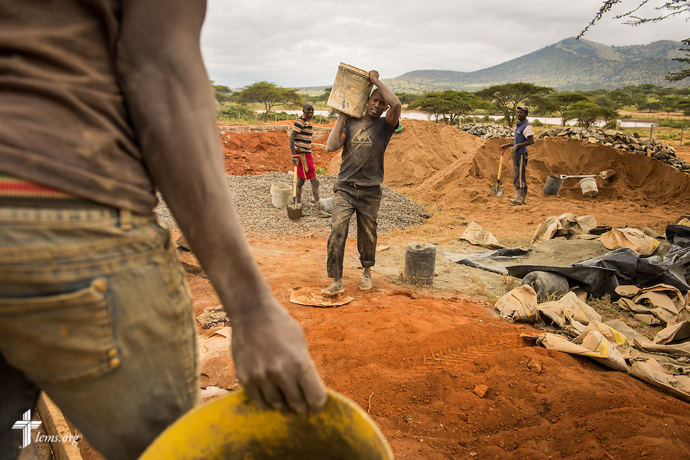Workers build the Lenkishon ELCK (Evangelical Lutheran Church in Kenya) Project 24 site on Saturday, June 25, 2016, in Lenkishon, Kenya.  LCMS Communications/Erik M. Lunsford