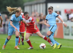 Bristol Academy Womens' Natalia Pablos Sanchon is challenged by Manchester City Womens' Keira Walsh (left) and Manchester City Womens' Krystle Johnston (right) - Photo mandatory by-line: Dougie Allward/JMP - Mobile: 07966 386802 - 28/09/2014 - SPORT - Women's Football - Bristol - SGS Wise Campus - Bristol Academy Women's v Manchester City Women's - Women's Super League