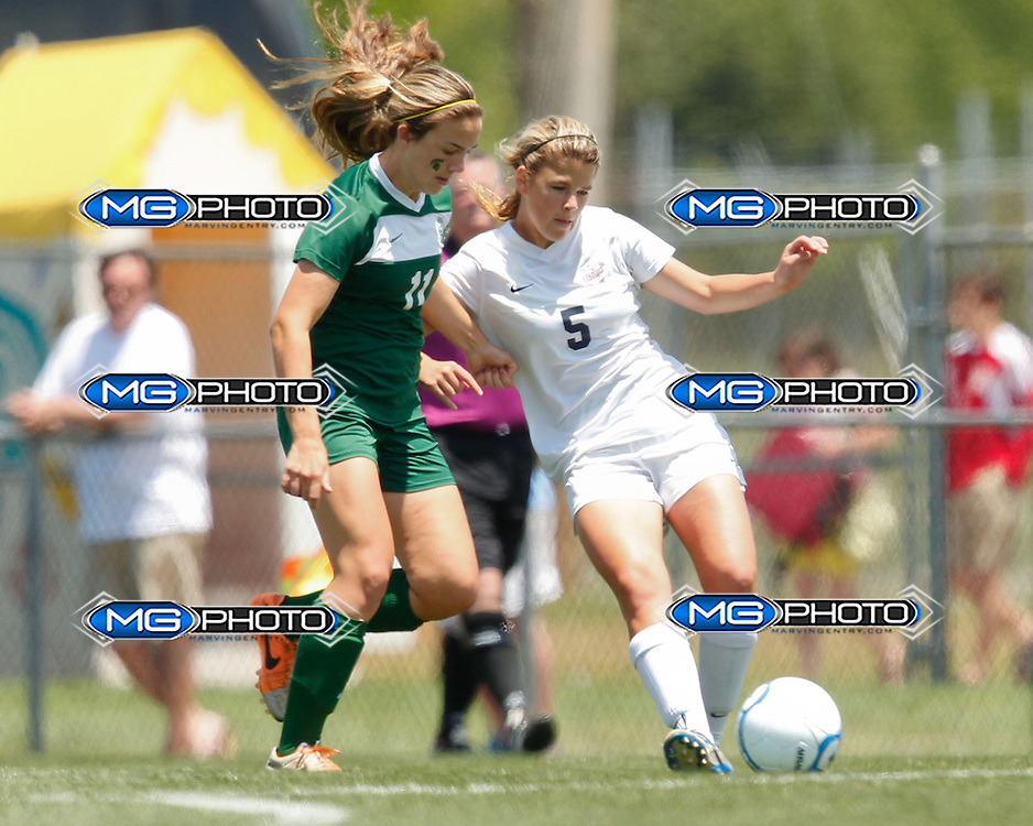May 10, 2014; Huntsville, AL, USA;  Oak Mountain Alexandra Glenn Dunn (5) controls the ball from Mountain Brook Leigh Haynes (11) during the 6A State Soccer Championship at John Hunt Soccer Complex. Mandatory Credit: Marvin Gentry