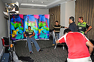 Makhaya Ntini preparing for a TV interview, watched by Nicky Boje, second from rignt, during the Warriors press conference held at The Radisson Blu  hotel in Port Elizabeth on the 7th September 2010 held as part of the build up to the Champions League T20 tournament being held in South Africa between the 10th and 26th September 2010..Photo by: Deryck Foster/SPORTZPICS/CLT20