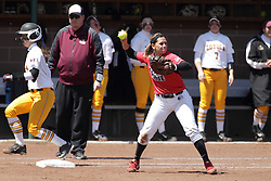 26 April 2015:   Jordan de los Reyes gets the put out throw on first base during an NCAA Missouri Valley Conference (MVC) Championship series women's softball game between the Loyola Ramblers and the Illinois State Redbirds on Marian Kneer Field in Normal IL